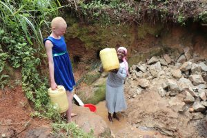 The Water Project:  Collecting Water