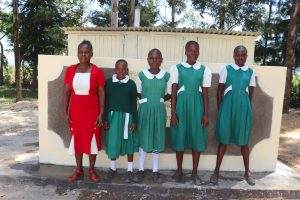 The Water Project:  The Ladies With Their Teacher At The Latrines