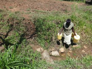 The Water Project:  Community Member Arrives At The Spring