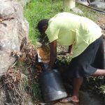 The Water Project: Mahira Community, Kusimba Spring -  Collecting Water