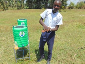The Water Project:  Student Elvis Demonstrates Handwashing