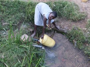 The Water Project:  Collecting Water From Chisombe Spring