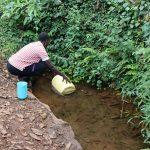 The Water Project: Harambee Community, Elijah Kwalanda Spring -  Nillah Imbusi Collects Water