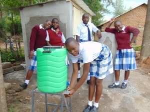 The Water Project:  Girls Wash Hands Outside Their New Latrines