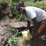 The Water Project: Mahira Community, Jairus Mwera Spring -  Collecting Water