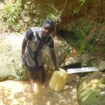 The Water Project: Mahira Community, Wora Spring -  Collecting Water