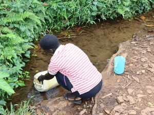 The Water Project:  Nillah Collecting Water