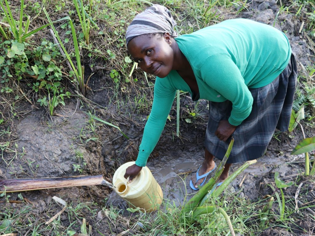 The Water Project : 29-kenya20168-grace-collects-water-at-mausi-spring-4