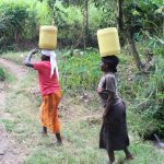 The Water Project: Litinye Community, Shivina Spring -  Carrying Water