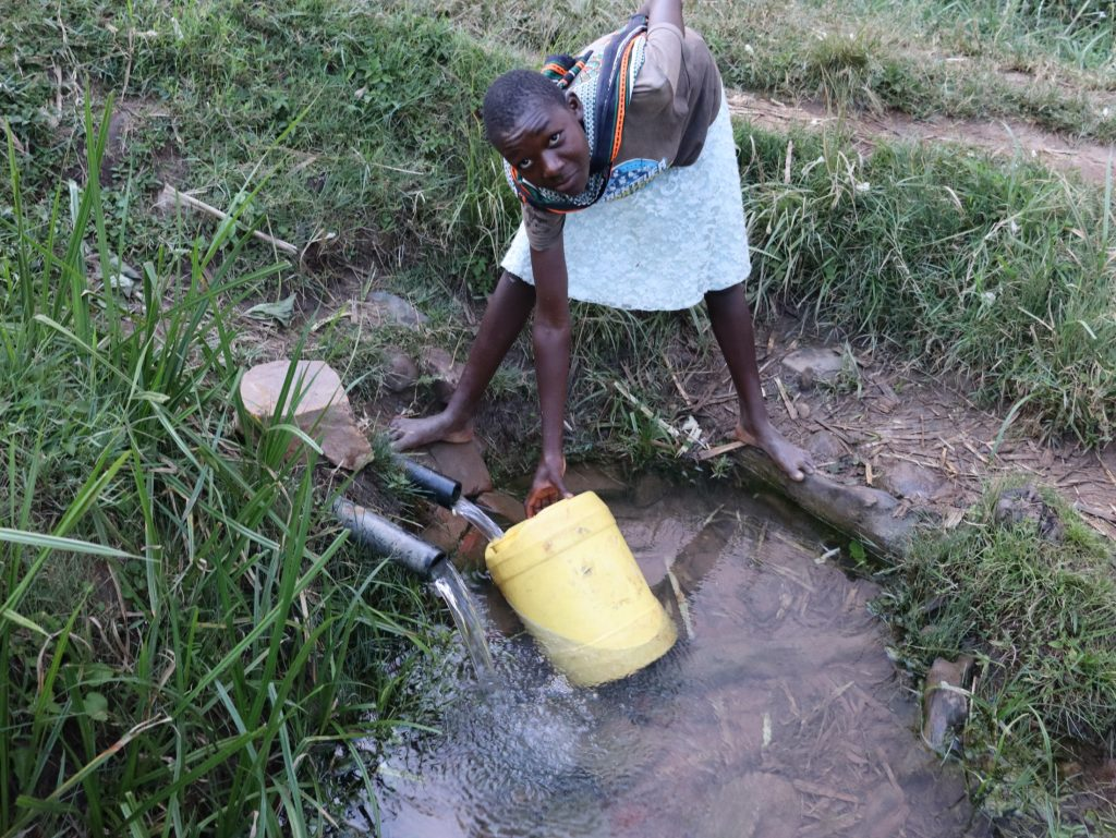 The Water Project : 29-kenya20180-collecting-water-from-chisombe-spring-4