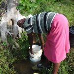The Water Project: Mahira Community, Kusimba Spring -  Collecting Water At The Spring