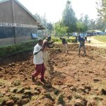 The Water Project: St. Peter's Khaunga Secondary School -  Community Members Help Excavate Rain Tank Site