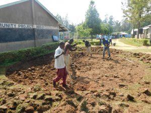 The Water Project:  Community Members Help Excavate Rain Tank Site