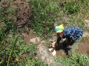 The Water Project:  Collecting Water At The Spring