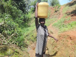 The Water Project:  A Woman Carrying Water