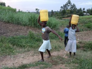 The Water Project:  Young Girls Ferrying Water