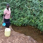 The Water Project: Harambee Community, Elijah Kwalanda Spring -  Topping Off Her Water