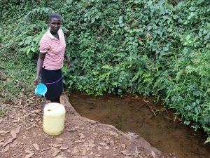 The Water Project:  Topping Off Her Water