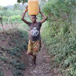 The Water Project: Mukhonje Community, Mausi Spring -  Carrying Water