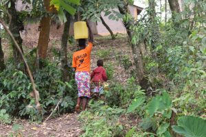 The Water Project:  Joy And Mom Beatrice Carry Water Home