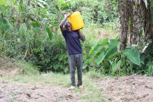 The Water Project:  Mark Carrying Water