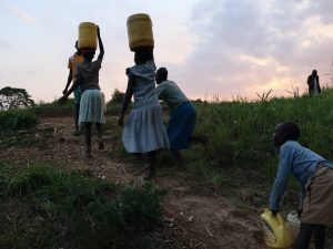The Water Project:  Carrying Water From Chisombe Spring