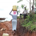 The Water Project: Mahira Community, Wora Spring -  Leaving The Collection Point