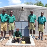 The Water Project: Friends School Mahira Primary -  The Gents At The Front Of The Tank