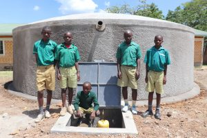 The Water Project:  The Gents At The Front Of The Tank
