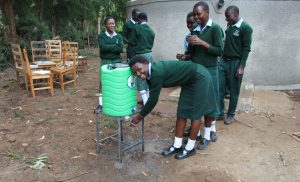 The Water Project:  Girls Using A Handwashing Point