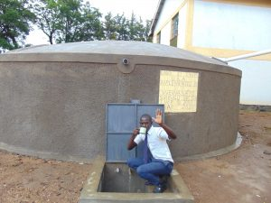 The Water Project:  Student Abraham Drinking Water