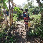 The Water Project: Mahira Community, Jairus Mwera Spring -  Alice Carrying Her Baby And Water Home