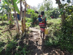 The Water Project:  Alice Carrying Her Baby And Water Home