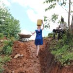 The Water Project: Mahira Community, Wora Spring -  Carrying Water
