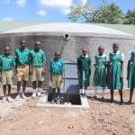 The Water Project: Friends School Mahira Primary -  Students Posing In Front Of The Tank