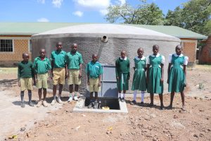 The Water Project:  Students Posing In Front Of The Tank