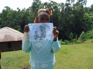 The Water Project:  Community Health Volunteer Nancy Khagai Shows A Training Poster