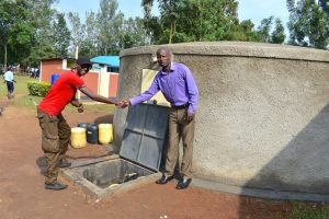 The Water Project:  Handing Over Session At The Rain Tank