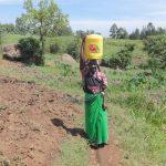 The Water Project: Mahira Community, Jairus Mwera Spring -  Alice Khavakali Carries Water Home