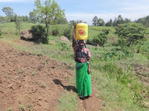 The Water Project:  Alice Khavakali Carries Water Home