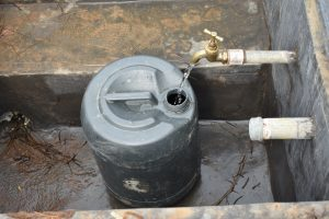 The Water Project:  Clean Water Flowing From Rain Tank