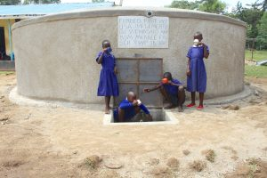 The Water Project:  Pupils Drinking Water From The Tank