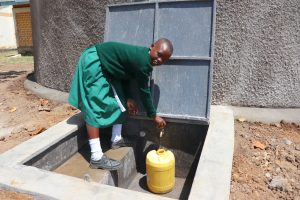 The Water Project:  Fetching Water At The Tank
