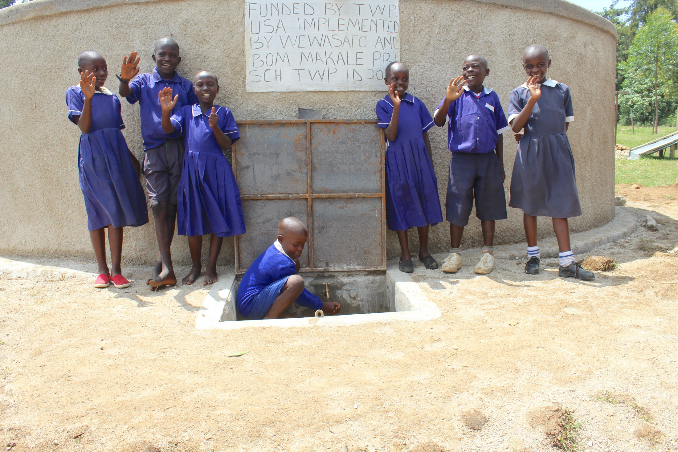 The Water Project : 38-kenya20105-students-posing-at-the-rain-tank