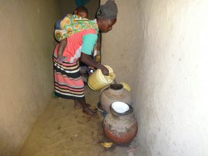 The Water Project:  Pouring Water Into Storage Pot