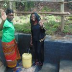The Water Project: Bukhaywa Community, Ashikhanga Spring -  Georgina On Right With Community Member
