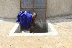 The Water Project:  Kenya Smiles At The Rain Tank
