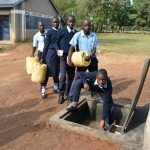 The Water Project: St. Peter's Khaunga Secondary School -  Collecting Water For Kitchen Use