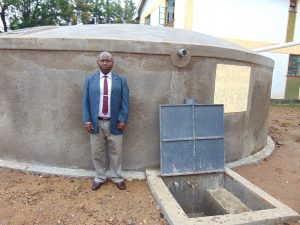 The Water Project:  Deputy Head Teacher Moses Kisiangani