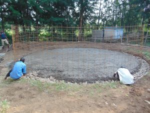 The Water Project:  Affixing Wire Reinorcement For Tank Walls